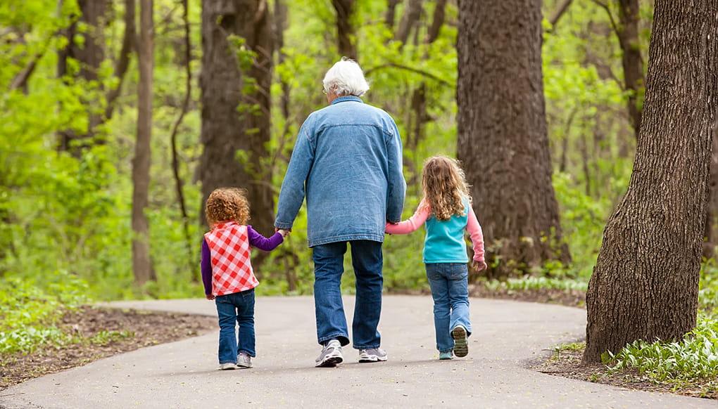 Grandparents holding hands w/kids