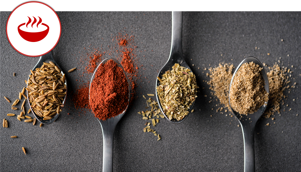 Colorful spices on spoons